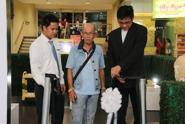 Artist Jun Filamor (Center) with representatives from SM Bicutan